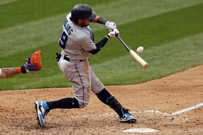 FILE - Miami Marlins' Miguel Rojas hits an RBI single during the sixth inning of a baseball game against the New York Mets in New York, in this Monday, Aug. 31, 2020, file photo. Rojas has been with the Marlins since 2015, longer than any other player. He's a perfect fit for a small-budget team because he's an overachiever, and thus a sound investment. (AP Photo/Adam Hunger, File)