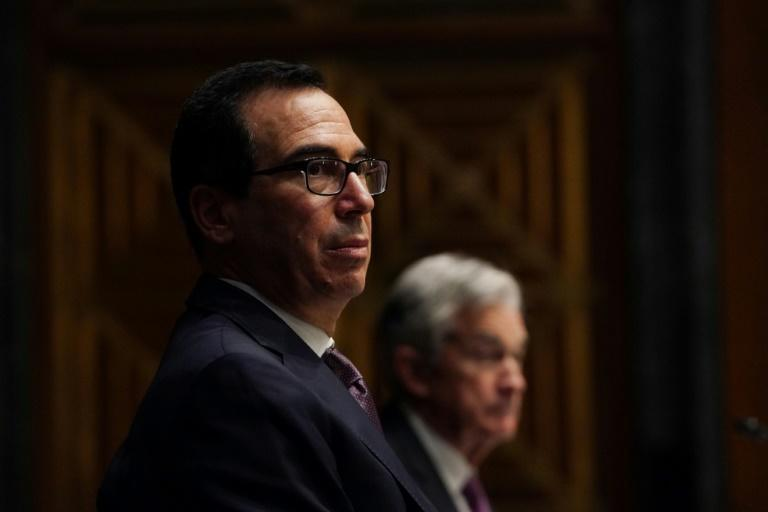 Treasury Secretary Steven Mnuchin (left) and Federal Reserve Chair Jerome Powell (right) have disagreed on whether emergency lending programs should be extended