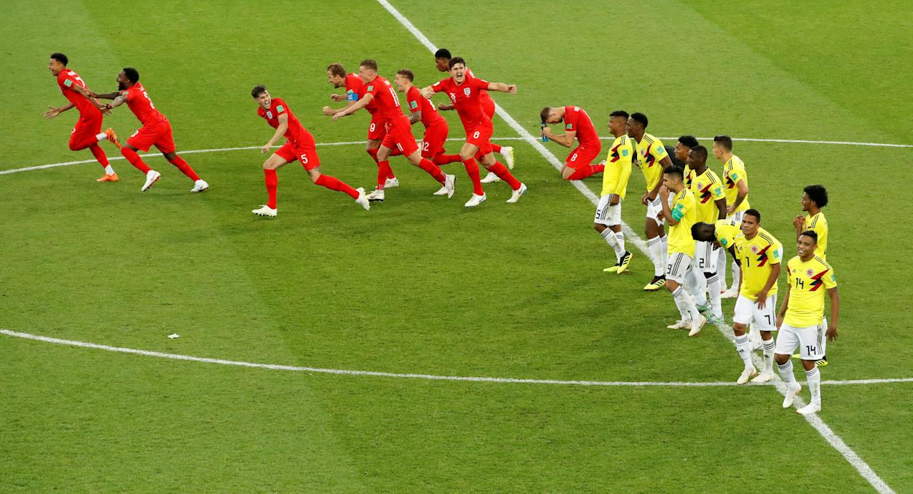 <p>England players celebrate while Colombia react after the penalty shootout. REUTERS/Christian Hartmann </p>