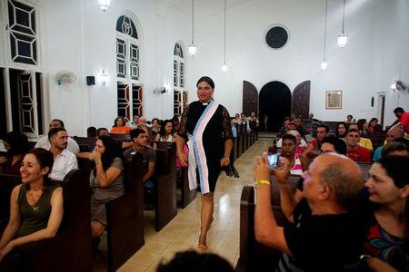 Alexya Salvador (C), a Brazilian trans pastor, walks during a mass in a church in Matanzas