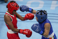 Columbia's Ingrit Lorena Valencia Victoria, left, exchanges punches with India's Chungneijang Mery Kom Hmangte during their women's flyweight 51-kg boxing match at the 2020 Summer Olympics, Thursday, July 29, 2021, in Tokyo, Japan. (AP Photo/Frank Franklin II)