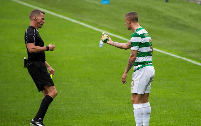Celtic player is targeted by a fan with a bottle of Buckfast - Credit: Liam McBurney/PA