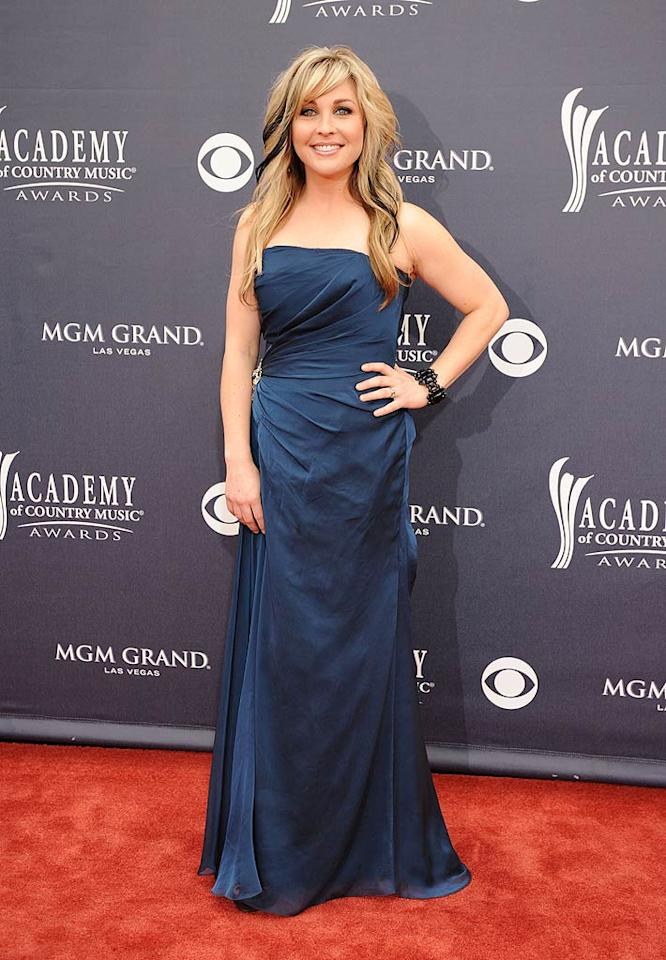 """Sunny Sweeney  Grade: B-   Aside from her skunk-like locks, Sunny Sweeney played it safe in a navy, strapless number. Denise Truscello/<a href=""""http://www.wireimage.com"""" target=""""new"""">WireImage.com</a> - April 3, 2011"""