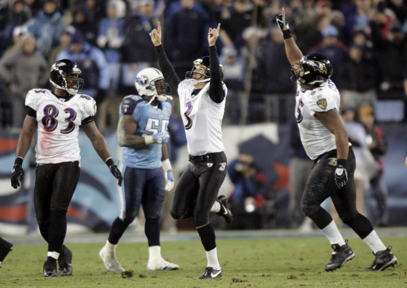 FILE - In this Jan. 10, 2009, file photo, Baltimore Ravens' Matt Stover (3) celebrates as Tennessee Titans linebacker Stephen Tulloch (55) walks away after Stover kicked a 43-yard field goal with 53 seconds left in the fourth quarter to give the Ravens a 13-10 win in an NFL football divisional playoff game in Nashville, Tenn. At left is Ravens tight end Daniel Wilcox (83) and at right is center Chris Chester. The Titans playing the Ravens in the divisional round on Saturday night, Jan. 11, has revived strong memories of a very intense and bitter playoff rivalry along with the agony of possible Super Bowl titles lost. (AP Photo/Wade Payne, File)