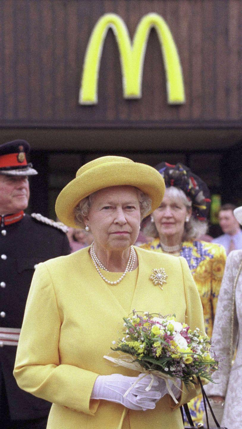 <p>Princess Diana isn't the only royal who likes McDonald's! Here, Queen Elizabeth II is seen outside a drive-through location at the Cheshire Oaks Designer Outlet. Sure, maybe she was just making an appearance that was located n<em>e</em>ar the restaurant, but it's undeniable that her outfit matches the golden arches.</p>