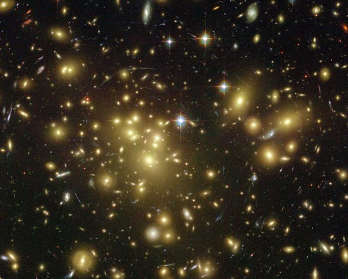 """<span class=""""caption"""">Dark matter can be inferred from an assortment of physical clues in the universe.</span> <span class=""""attribution""""><a class=""""link rapid-noclick-resp"""" href=""""https://en.wikipedia.org/wiki/Dark_matter#/media/File:Gravitationell-lins-4.jpg"""" rel=""""nofollow noopener"""" target=""""_blank"""" data-ylk=""""slk:NASA"""">NASA</a></span>"""