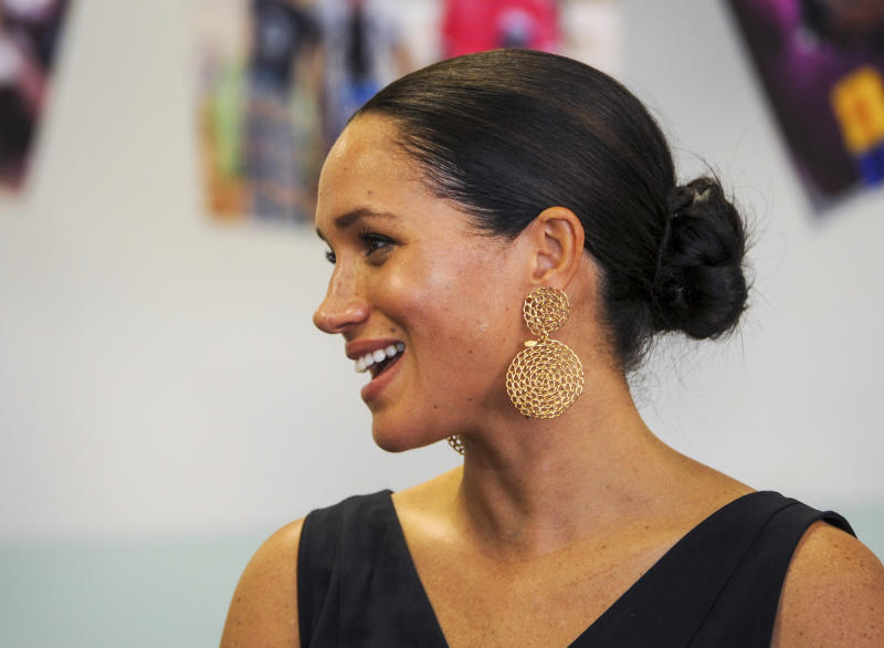 Britain's Meghan Duchess of Sussex, visits the Mothers2Mothers organisation, which trains and employs women living with HIV as frontline health workers across eight African nations, in Cape Town, South Africa, Wednesday, Sept. 25, 2019. The British royal couple Prince Harry and Meghan are on the third day of their African tour. (Henk Kruger / African News Agency via AP, Pool)