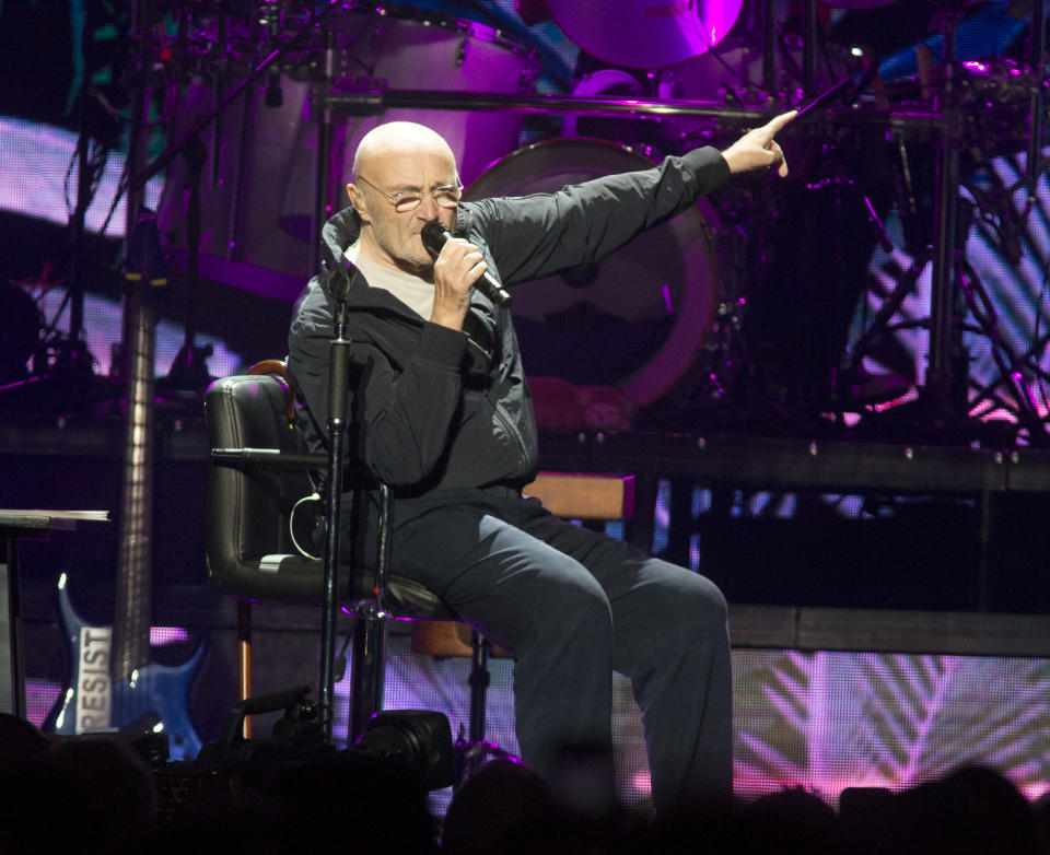 """FILE - Phil Collins performs during his """"Not Dead Yet Tour"""" in Philadelphia on Oct. 8, 2018. Collins is among several musicians who are objecting to their songs being used at President Donald Trump's campaign rallies. (Photo by Owen Sweeney/Invision/AP, File)"""