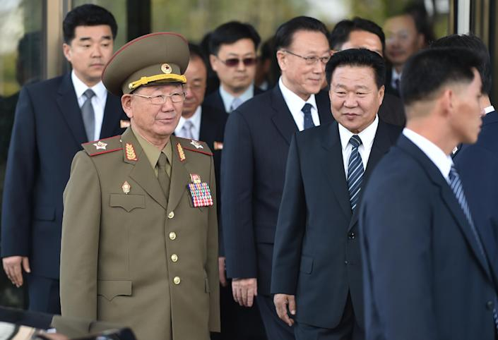 Hwang Pyong-So (2nd L), director of the military's General Political Bureau, the top military post in North Korea, walks with other N.Korean officials, following a meeting in Incheon, South Korea, on October 4, 2014 (AFP Photo/Bay Ismoyo)