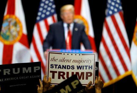 Supporters hold up signs while listening to Republican U.S. presidential candidate Donald Trump during a campaign rally in Tampa, Florida, U.S. June 11, 2016.  REUTERS/Scott Audette