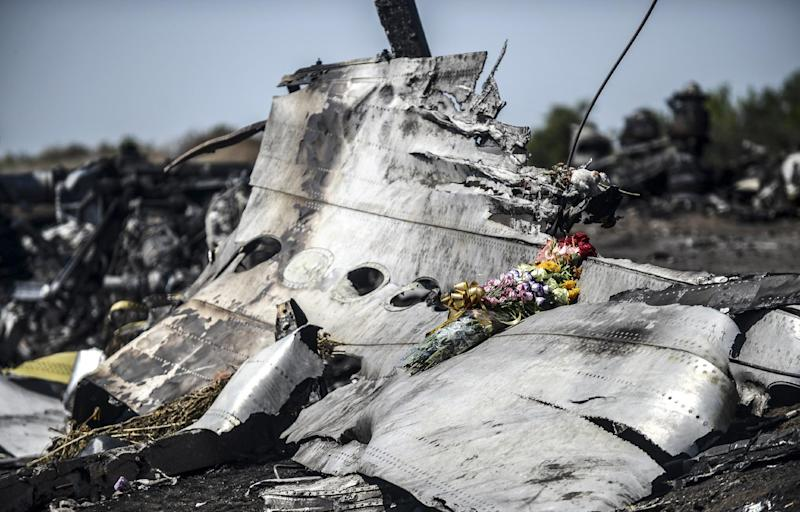 This photo taken on July 26, 2014 shows flowers -- left by parents of an Australian victim of the crash -- laid on the wreckage of Malaysia Airlines flight MH17 near the Ukrainian village of Hrabove (Grabove)