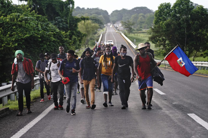 Haitian migrants walk along the highway in Huixtla, Chiapas state, Mexico, early Thursday, Sept. 2, 2021, in their journey north toward the U.S. (AP Photo/Marco Ugarte)