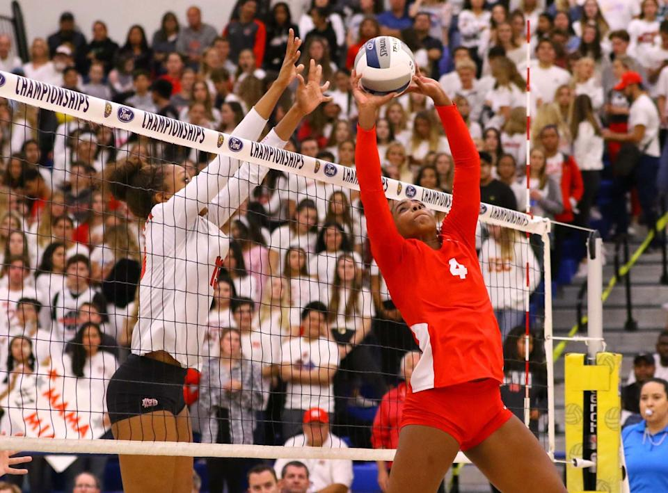 """Redondo Union's Kami Miner (4) looks to set the volleyball while Mater Dei's Zaria Henderson (13) looks for a block. <span class=""""copyright"""">(Nick Koza)</span>"""