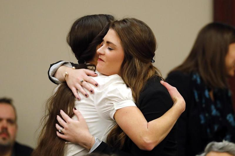 Gymnasts Rachael Denhollander and Larissa Boyce embrace following the court hearing (AP)