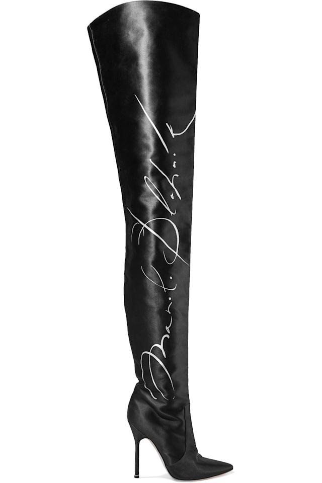 """<p>Buy it <a rel=""""nofollow"""" href=""""https://www.net-a-porter.com/us/en/product/875113/Vetements/-manolo-blahnik-printed-satin-thigh-boots"""">here</a> for $3,380.</p>"""