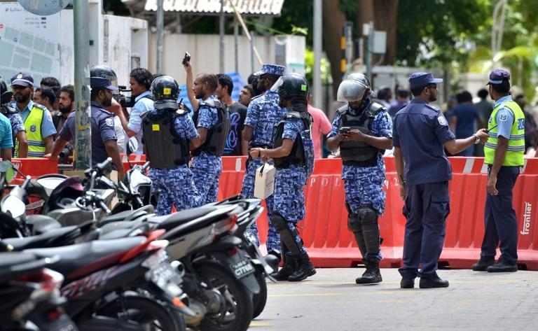 Maldives police patrol the streets of the capital Male on October 24, 2015