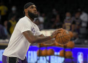 Los Angeles Lakers forward LeBron James (6) warms up before playing the Phoenix Suns in a preseason NBA basketball game in Los Angeles, Sunday, Oct. 10, 2021. (AP Photo/John McCoy)