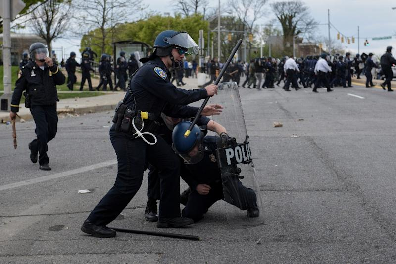 Baltimore police officers clash with protesters in the streets near Mondawmin Mall on April 27, 2015 in Baltimore