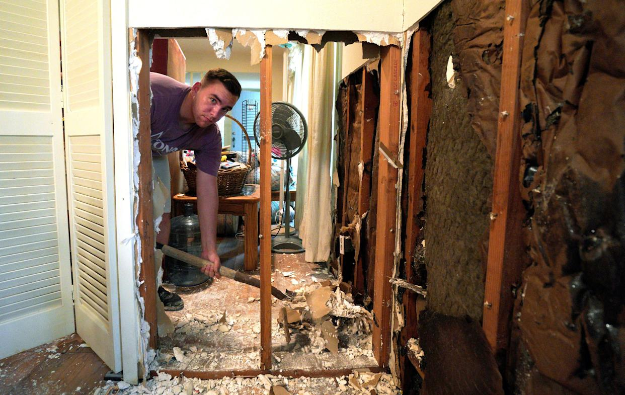 A volunteer from Texas A&M University helps to clean up flood damage in the house of an alumnus in Houstonon Sept. 2.