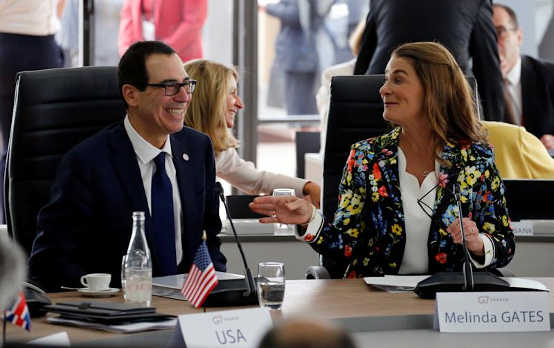 U.S. Treasury Secretary Steven Mnuchin and philanthropist Melinda Gates, Co-Chair of the Bill and Melinda Gates Foundation, attend a meeting during the G7 finance ministers and central bank governors meeting in Chantilly, near Paris, France, July 18, 2019. REUTERS/Pascal Rossignol