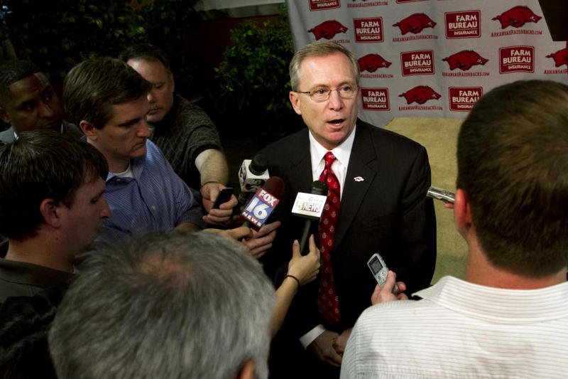 Arkansas athletic director Jeff Long speaks to reporters at an NCAA college football news conference in Fayetteville, Ark., Tuesday, April 24, 2012. (AP Photo/Gareth Patterson)