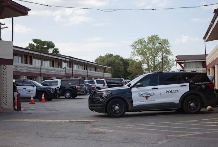 Fort Worth police were on scene investigating Tuesday in a room at the Mid City Inn, an extended-stay motel in the 1400 block of West Euless Boulevard in Euless, where the suspect in a triple homicide had been staying.