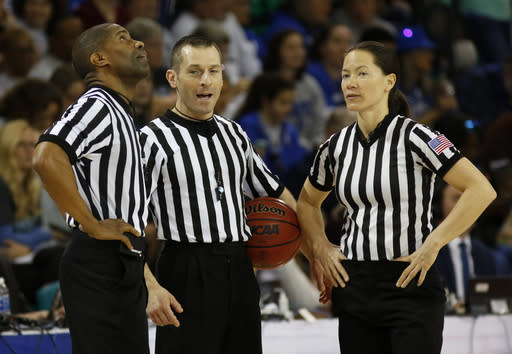 In this Sunday, March 5, 2017, photo, officials Eric Brewton, left, Joe Vaszily, center, and Maj Forsberg stand together during a timeout during the women's basketball game between Duke and Notre Dame at the NCAA college championship basketball game in the Atlantic Coast Conference tournament at the HTC Center in Conway, S.C. Vaszily has worked the last seven Final Fours is looking forward to starting his 21st year this week of Monday, Nov. 23, 2020. He said that a lot of his officiating colleagues are looking forward to the season despite the higher level of anxiety because of the virus. (AP Photo/Mic Smith)