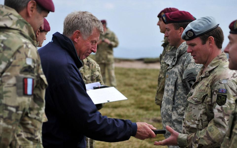 General Sir Cedric Delves awards then-Major Dom Nicholls his Operational Service Medal for service in Afghanistan, on top of Pen-Y-Fan, Brecon Beacons, Wales. Photo taken June 2011. - Rupert Frere RLC/Crown Copyright