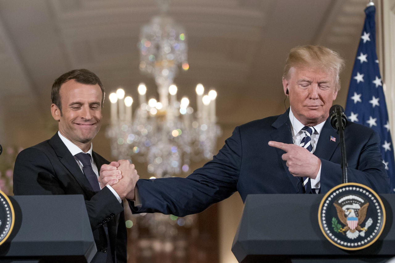 President Donald Trump and French President Emmanuel Macron shake hands during a news conference in the East Room of the White House in Washington, Tuesday, April 24, 2018. (AP Photo/Andrew Harnik)