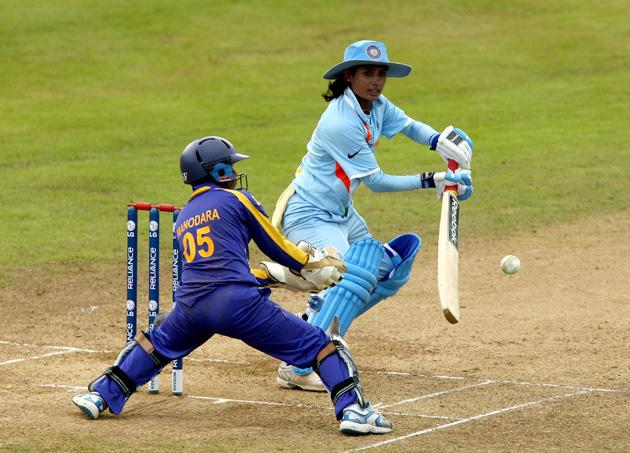 Mithali Raj of India clips the ball away during the ICC Women's Twenty20 World Cup match between India and Sri Lanka at The County Ground on June 15, 2009 in Taunton, England.  (Photo by Richard Heathcote/Getty Images) *** Local Caption *** Mithali Raj;Dilani Manodara
