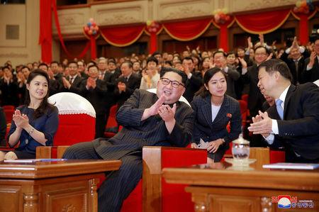 North Korean leader Kim Jong Un and his wife Ri Sol Ju applaud with Song Tao, head of the International Department of Communist Party of China (CPC) Central Committee, in this undated photo released by North Korea's Korean Central News Agency (KCNA) in Pyongyang April 17, 2018. KCNA/via Reuters