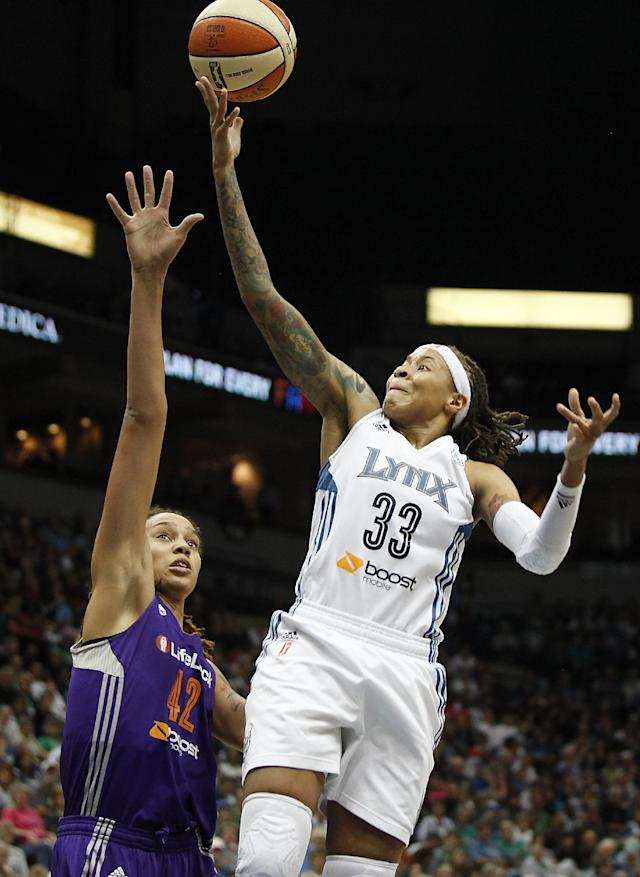 Minnesota Lynx guard Seimone Augustus (33) goes to the basket against Phoenix Mercury center Brittney Griner (42) during Game 1 of the WNBA basketball playoffs Western Conference finals on Thursday, Sept. 26, 2013, in Minneapolis. (AP Photo/Stacy Bengs)