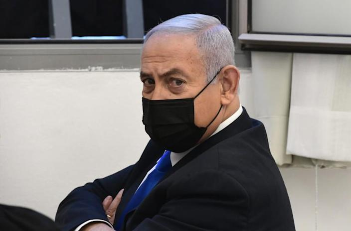 Israeli Prime Minister Benjamin Netanyahu looks on prior to a hearing at the district court in Jerusalem, Monday, Feb. 8, 2021. Netanyahu appeared in a Jerusalem courtroom Monday to respond formally to corruption charges just weeks before national elections in which he hopes to extend his 12-year rule. (AP Photo/Reuven Castro, Pool)