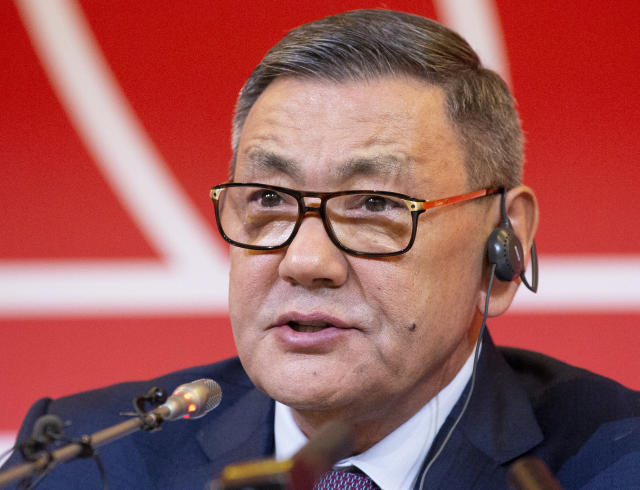 FILE - In this file photo dated Saturday, Nov. 3, 2018, the new president of the amateur boxing federation Gafur Rakhimov speaks to the media upon becoming the head of AIBA in Moscow, Russia. Rakhimov, a businessman with alleged links to organized crime, resigned Monday July 15, 2019, as president of the International Boxing Association after his tenure played a role in the body being stripped of the right to organize the Olympic boxing events. (AP Photo/Alexander Zemlianichenko, FILE)