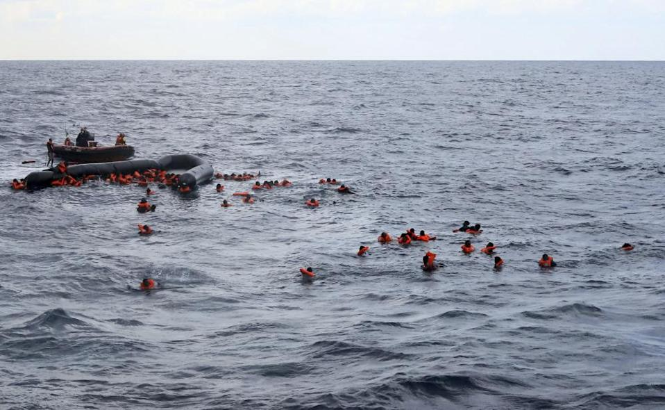 Migrants are rescued by members of the Spanish NGO Proactiva Open Arms