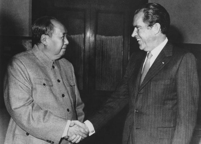 FILE - In this Feb. 21, 1972, file photo, Chinese communist party leader Mao Zedong, left, and U.S. President Richard Nixon shake hands as they meet in Beijing, China. Tossed into the middle of a potential thawing in U.S. relations with China, Judy Bochenski and her American ping pong teammates helped deliver one of the great diplomatic coups of their time. Their hastily arranged trip for exhibitions in three Chinese cities helped part the Red Curtain and open the way to a new world order that included China. It worked so well that President Richard Nixon would get on Air Force One the next year to make a state visit to China that enthralled the world.(AP Photo/File)