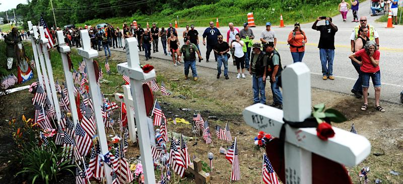 FILE - In this July 6, 2019, file photo, motorcyclists visit a memorial for seven bikers killed in a collision with a pickup truck last month while participating in the Ride for the Fallen 7 in Randolph, N.H. In a preliminary report released Wednesday, July 24, 2019, the National Transportation Safety Board summarized the details behind the June 21 crash in which a pickup truck driven by Volodymyr Zhukovskyy crashed into the bikers in Randolph, N.H. The report affirms early reports that Zhukovskyy crossed the center of the road and collided with the bikers.(Paul Hayes/Caledonian-Record via AP, File)