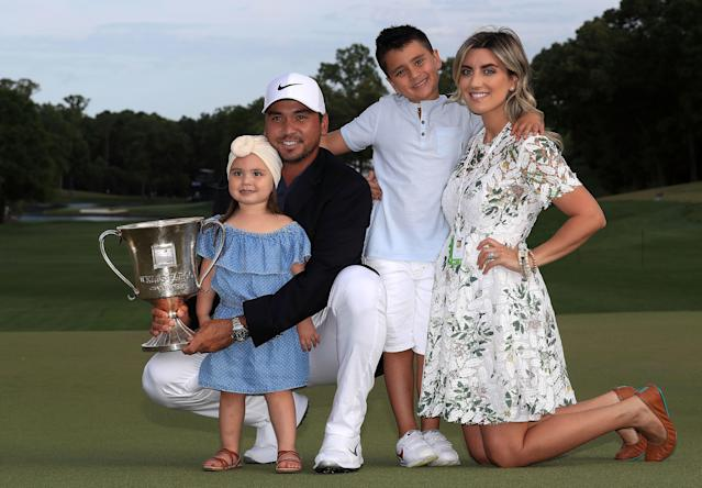"""<div class=""""caption""""> Day and his wife, Ellie, pose with their children, Lucy and Dash, on the 18th green after winning the 2018 Wells Fargo Championship. </div> <cite class=""""credit"""">Sam Greenwood/Getty Images</cite>"""