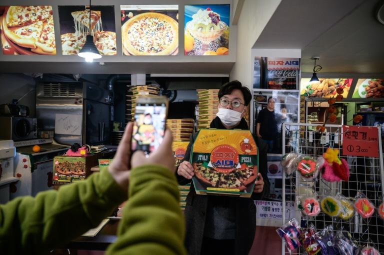 Sales have doubled at Sky Pizza in southern Seoul, a nondescript 10-seat restaurant and takeaway where a scene from 'Parasite' was filmed (AFP Photo/Ed JONES)