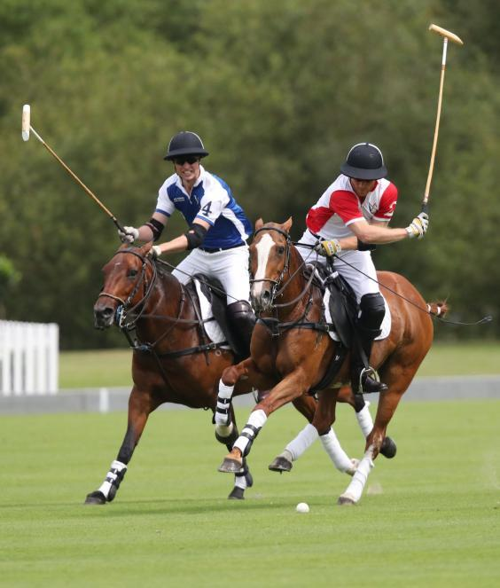 Dukes of Cambridge and Sussex participate in charity polo match together in Berkshire (Andrew Matthews/PA Wire)