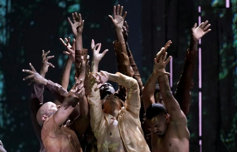 """Dancers perform a scene during a rehearsal for Terence Blanchard's """"Fire Shut Up in My Bones"""" (AFP/TIMOTHY A. CLARY)"""
