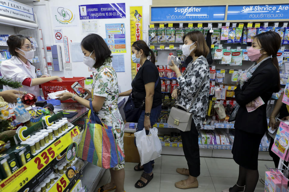 People queue at a pharmacy to�buy face�masks at Siam square, following the outbreak. Bangkok is facing a shortage of protective surgical masks. The coronavirus originating from Wuhan China has spread across Asia causing panic in multiple countries inducing Thailand. Thailand has detected 25 cases. The virus has so far killed at least 425 people with over 20627 confirmed cases worldwide. (Photo by Patipat Janthong / SOPA Images/Sipa USA)