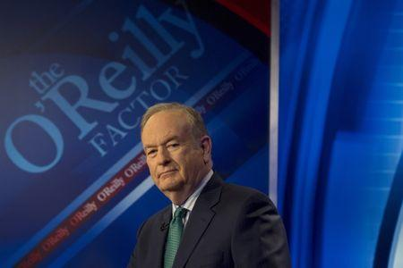 """Fox News Channel host Bill O'Reilly poses on the set of his show """"The O'Reilly Factor"""" in New York"""