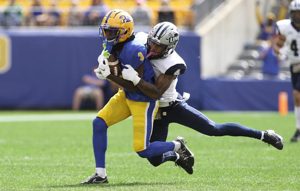 Pittsburgh Panthers wide receiver Jordan Addison (3) catches a pass against New Hampshire Wildcats defensive back Randall Harris (4) during the first quarter at Heinz Field.