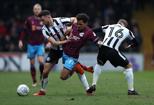 "Soccer Football - League One - Scunthorpe United vs Rochdale - Glanford Park, Scunthorpe, Britain - March 24, 2018 Scunthorpe United's Duane Holmes in action with Rochdale's Bradden Inman (L) and Matt Done Action Images/John Clifton EDITORIAL USE ONLY. No use with unauthorized audio, video, data, fixture lists, club/league logos or ""live"" services. Online in-match use limited to 75 images, no video emulation. No use in betting, games or single club/league/player publications. Please contact your account representative for further details."