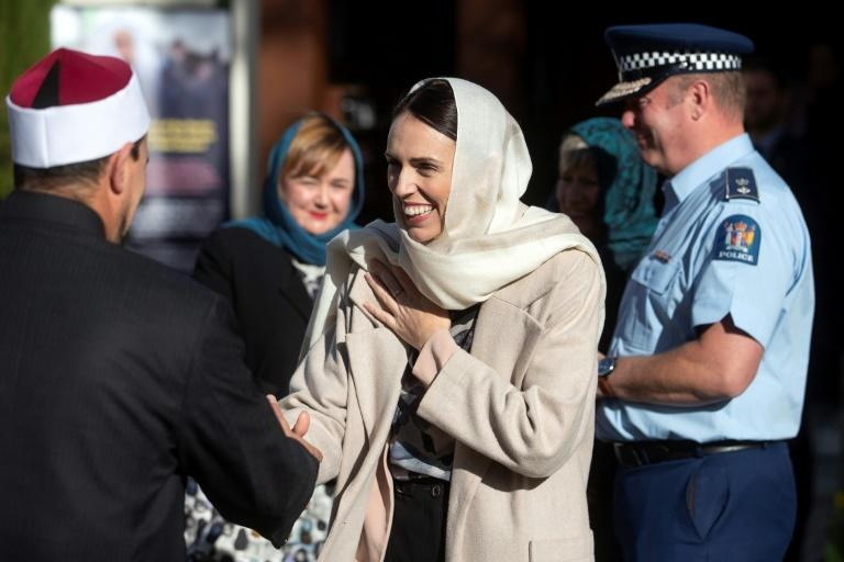 New Zealand's Prime Minister Jacinda Ardern wears a head scarf on a visit to the Al Noor mosque