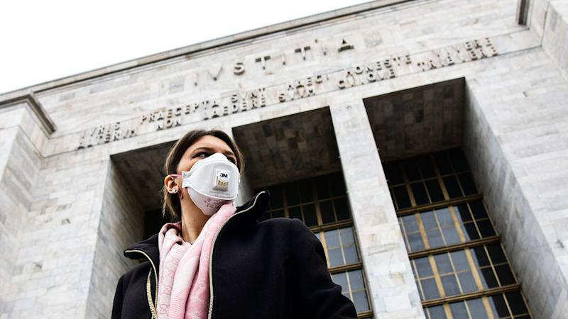 Pictured here, a man in Italy wears a face mask amid the coronavirus threat.
