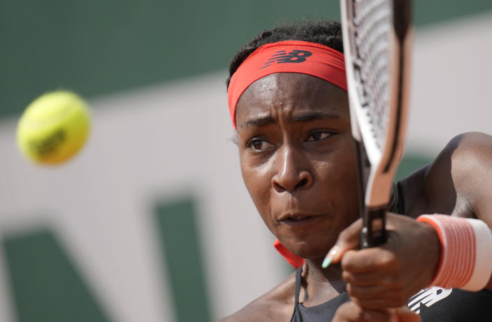 United States's Coco Gauff plays a return to China's Qiang Wang during their second round match on day 5, of the French Open tennis tournament at Roland Garros in Paris, France, Thursday, June 3, 2021. (AP Photo/Christophe Ena)
