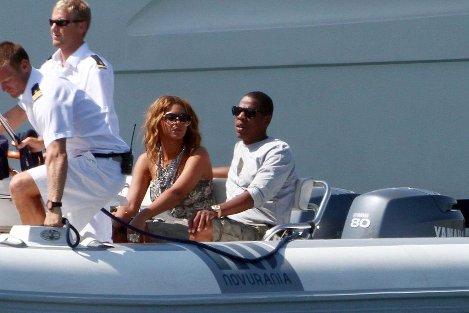 <p>This is a shot of Beyonce and Jay-Z taking a boat off of their other boat to get to their private jet. </p>