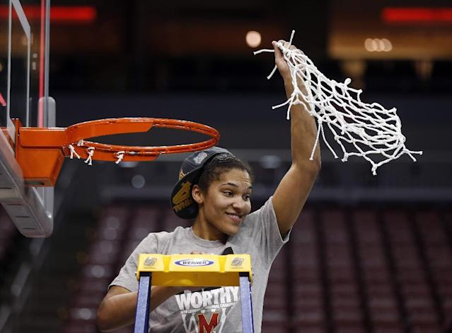 Maryland forward Alyssa Thomas (25) holds up the net after Maryland defeated Louisville 76-73 in an NCAA women's college basketball tournament regional final, Tuesday, April 1, 2014, in Louisville, Ky. (AP Photo/John Bazemore)